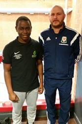 L-R: Philippe Roo Bantsi Mongapndam, Campus Sport Officer, Bangor University with Rob Franklin, Senior Partnership Manager, Welsh Football Trust