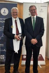 Dr Shaun Russell (left) with Her Majesty's Ambassador to Chile, Jamie Bowden CBE, at the investiture ceremony