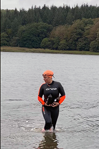 Laura Sanderson collecting water samples on her epic swim