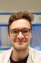 An image of PhD student Will Perry in the labs at Bangor University.
