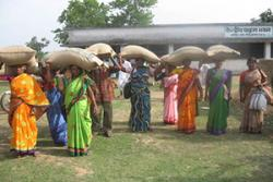 Women farmers taking away the certified seed bags of Ashoka 200F upland rice variety after a training session in Central Paraha Bhavan at Bero, Ranchi