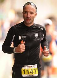 Cwblhaodd Xavier Laurent, aelod o staff gyda'r ICPS yn Ysgol y Gyfraith, triathlon Ironman Cymru mewn 14 awr a 15 munud.