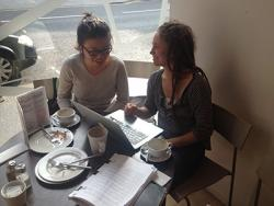 Yang Xi and Sophie work on the six month report for the British Council funding whilst enjoying tea and cake in an Edinburgh Café.