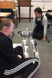 Bryana Donachie and Jessica Hartshorne, both of Rhyl, completing a human skeleton using x- ray images.