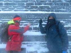 Alex (left) and Stephen at the summit of Snowdon
