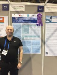 Dr Ridyard with award winning poster