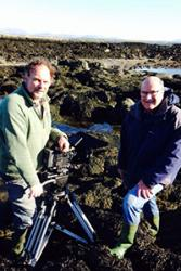 Cameraman Richard Kirby filming in Trearddur Bay with advice from Professor Chris Richardson of the School of Ocean Sciences.