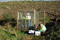 Collecting leachate from a capped landfill site