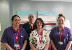 Student nurses Jennifer Griffiths, (left) and Charlotte Brown (right) with Eleri Williams, Deputy Manager and Mark Aldred, Senior Nurse at Merton Place in Colwyn Bay.