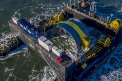 Deployment of OpenHydro's open-centre tidal turbine.: (image courtesy of OpenHydro)