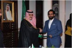 Othman receiving his award from the Saudi Ambassador to the UK