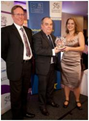 "Amy Sanders, Overarching Projects Coordinator & Director, Dynamix, being presented with the Award for ""Most Improved Supplier"" at the Welsh National Procurement Awards, 2013"