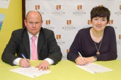 Richard Bennett (left) and Jo Caulfield sign the Charter