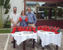 SENRGy's Lars Markesteijn, Genevieve Lamond and James Walmsley with Deiniol dragons and other Bangor University alumni gifts during the event in Accra, Ghana. July 2017.