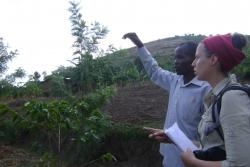 Laura Kmoch, a Bangor MSc Sustainable Tropical Forestry student, interviewing a farmer on his land in Namabya Sub-county, Manafwa District of Eastern Uganda. Photograph taken by Kenneth Eryau, February 2014.