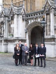 The students and Stephen Clear with MP Hywel Williams (3rd from left) in Westminster